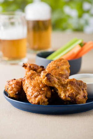 beer garden: Hot wing with celery carrot sticks at beer garden Stock Photo