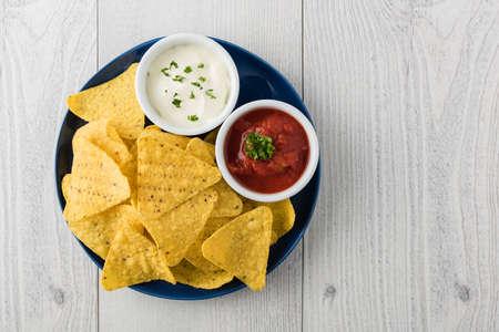 sour cream: Nachos with salsa and sour cream dips Stock Photo