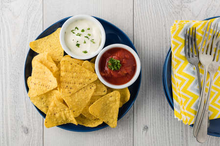 fingerfood: Nachos with salsa and sour cream dips Stock Photo