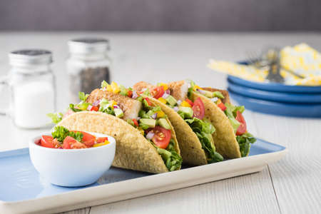 fingerfood: Fish tacos shell with tomato, beans, capsicum and avocado salsa