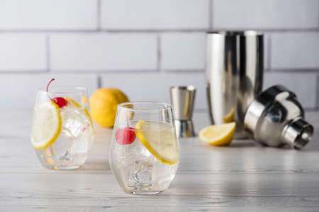 sweet vermouth: Fresh home made Tom Collins cocktails with lemon