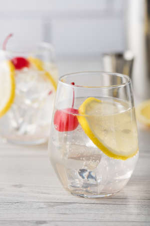 silver bars: Fresh home made Tom Collins cocktails with lemon