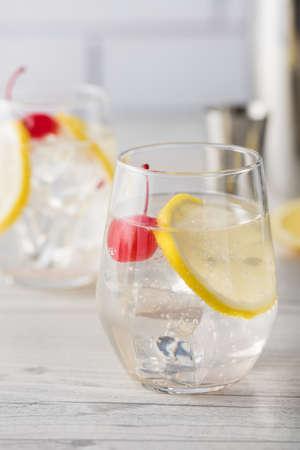 martini shaker: Fresh home made Tom Collins cocktails with lemon