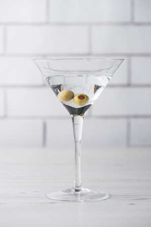 martini shaker: Fresh home made vodka martini cocktails with olives