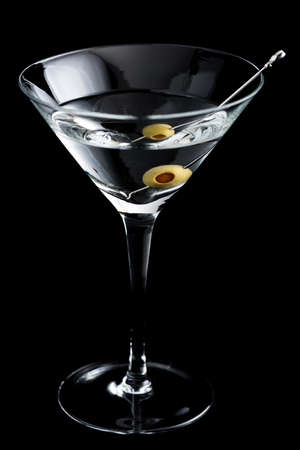 sweet vermouth: Vodka martin cocktail with olives on black background Stock Photo