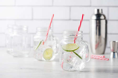 gin: Fresh home made gin tonic cocktails with lime