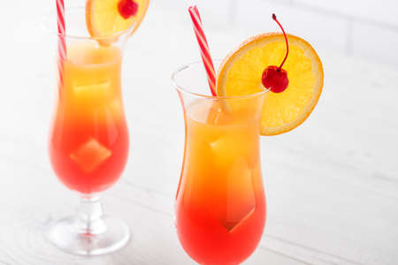 lemon wedge: Fresh home made Tequila sunrise with garnish