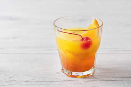 daiquiri alcohol: Fresh home made Mai Tai with orange and maraschino cherry garnish Stock Photo