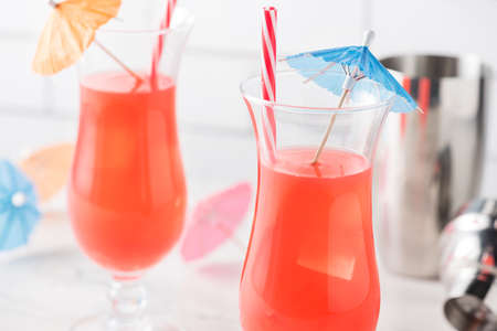 Fresh home made Singapore Sling with cocktails umbrella Stock Photo