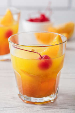 Fresh home made Mai Tai with orange and maraschino cherry garnish Stock Photo