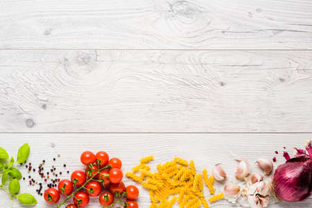 Italian cooking ingredients on a old rustic wooden table Stock Photo