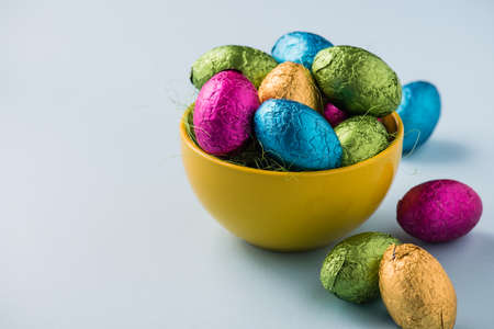 Decorative colourful easter eggs in metallic wrapping