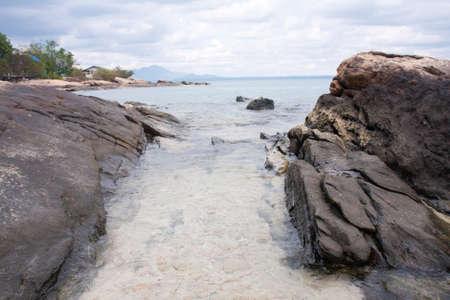 stone sea beach and the sky photo