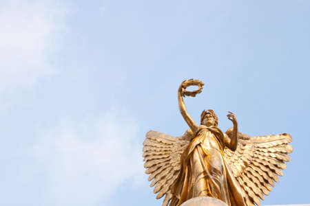 Goddess statue in the sky on a clear sky, beautiful clouds. Stock Photo
