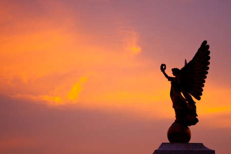 Goddess statue in the sky at the time the sun is about to sunset. Stock Photo - 8142737