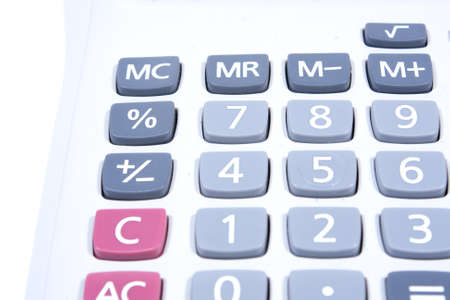 subtraction: Calculator on a white background. Using addition, subtraction, basic calculator.