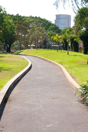 Winding way ahead is a tall building. Destination with huge winding way Stock Photo - 8587603