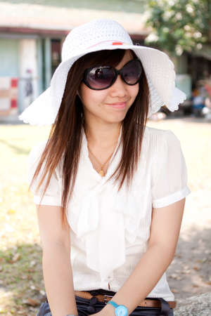 smiling young thai girl and white hat in travel.