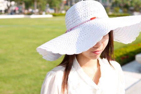 thai girl and withe hat in the garden on holiday photo