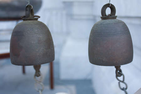 Two small bell hanging in the temple area.  photo