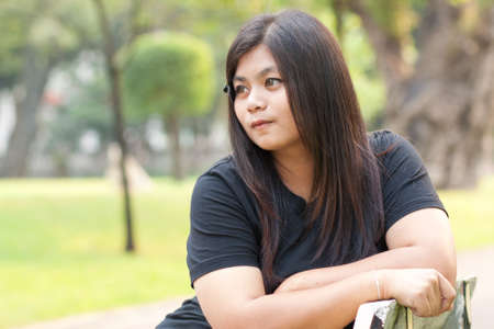 Woman sitting in a park looking vacant Stock Photo - 8893740