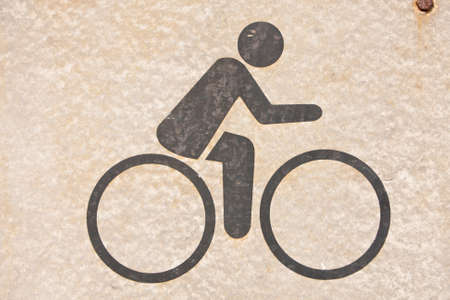 A symbol, people are cycling. On background   photo