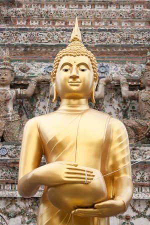 Buddha at Wat Arun, Bangkok travel gods of the Thai people. photo