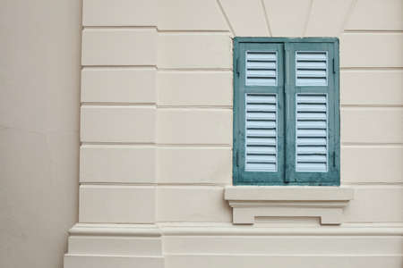 Classic green window on a wall of a building. Stock Photo - 9605515