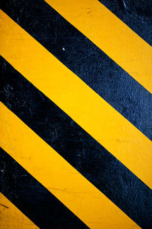 pattern yellow and black is sign warning something on the road. photo