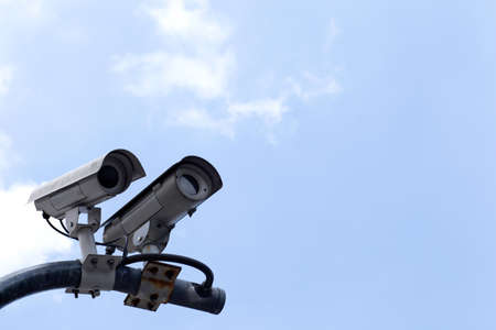 CCTV cameras on high towers in the background sky. photo
