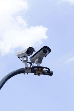 CCTV cameras on high towers in the background sky. Stock Photo - 10738270
