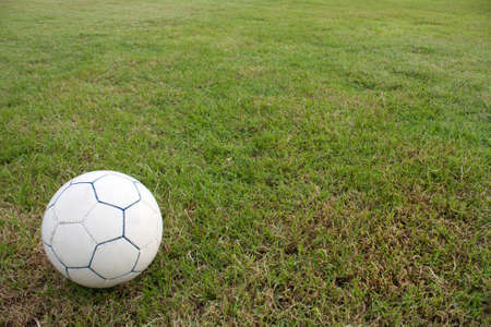 Soccer ball in the grass in the background. photo