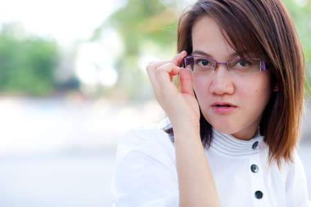 Woman looking for a serious and a little smile. Stock Photo - 10907350