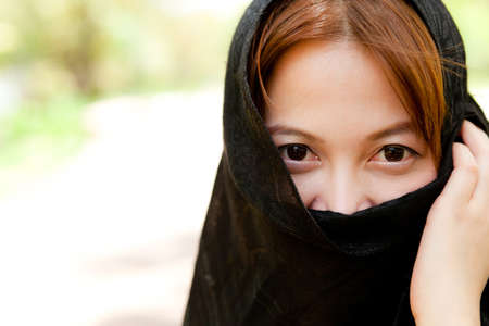 Woman and a black cloth off my eyes see only a portion of the page. Stock Photo - 10907351
