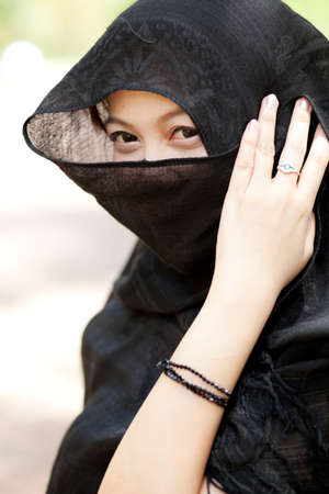 Woman and a black cloth off my eyes see only a portion of the page. Stock Photo - 10900793