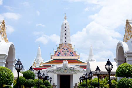 White Pagoda in the bright sky and clouds. photo