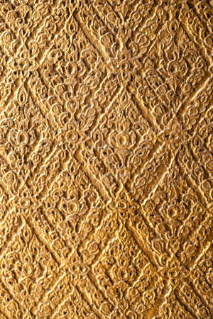 The background pattern is carved with the Thai national identity. photo
