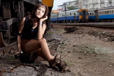 fashion portrait beauty asian girl in train station.portrait fashion outdoor.  photo
