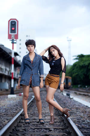 fashion portrait asian two girl in train station.portrait fashion on outdoor. photo