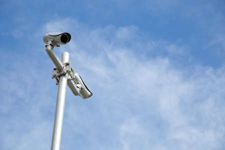 CCTV cameras are monitored. Security. On the bright sky. photo