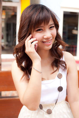 woman using the mobile phone.many active mobile phone. Stock Photo - 11727876