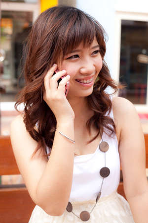 woman using the mobile phone.many active mobile phone. photo