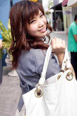 woman carry white bag shopping in mall.she happy buy shopping in mall. photo
