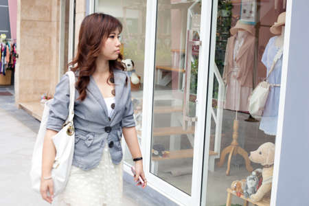 woman choose product shopping in mall.shopping in mall.  photo