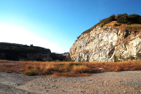 High mountain valleys, rocks, trees, up slightly at the top of the hill. Stock Photo - 12049622