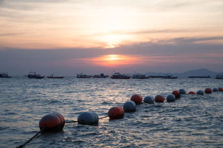 Buoy floating in the sea to space constraints. Who can swim. Stock Photo - 12265681