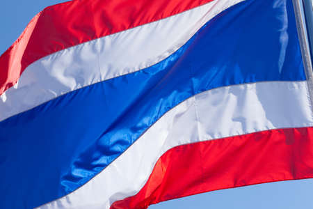 The Thai flag is waved pennants flutter. Behind the bright sky. photo