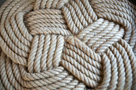 Coiled coil of rope to cross back and forth. Orderly Grilled coiled tightly together.