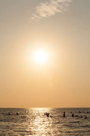 muggy: The sun goes down at sea, the sky is orange When the sun sets below