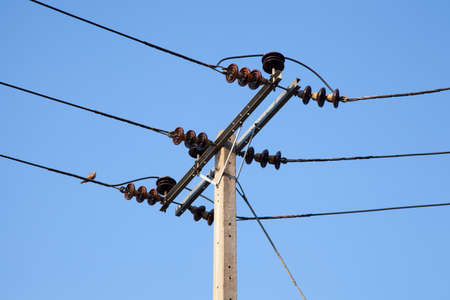 Poles are resistant to high voltage power supply to the accommodation. Stock Photo - 12629026